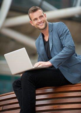 Businessman wth Laptop Outdoors