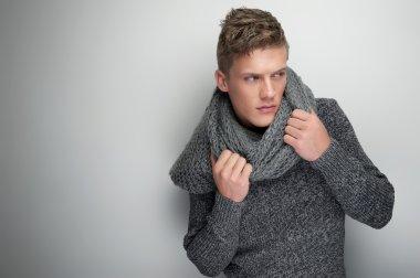 Handsome Man Holding Winter Scarf