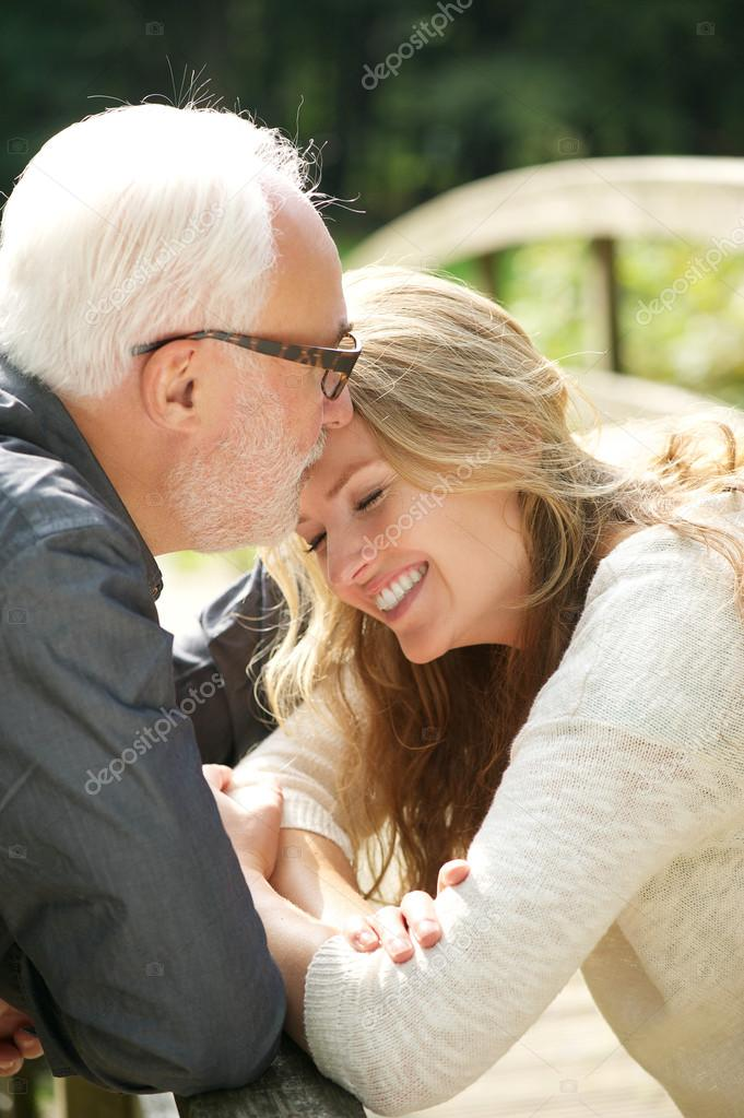Portrait of a happy daughter standing close to father