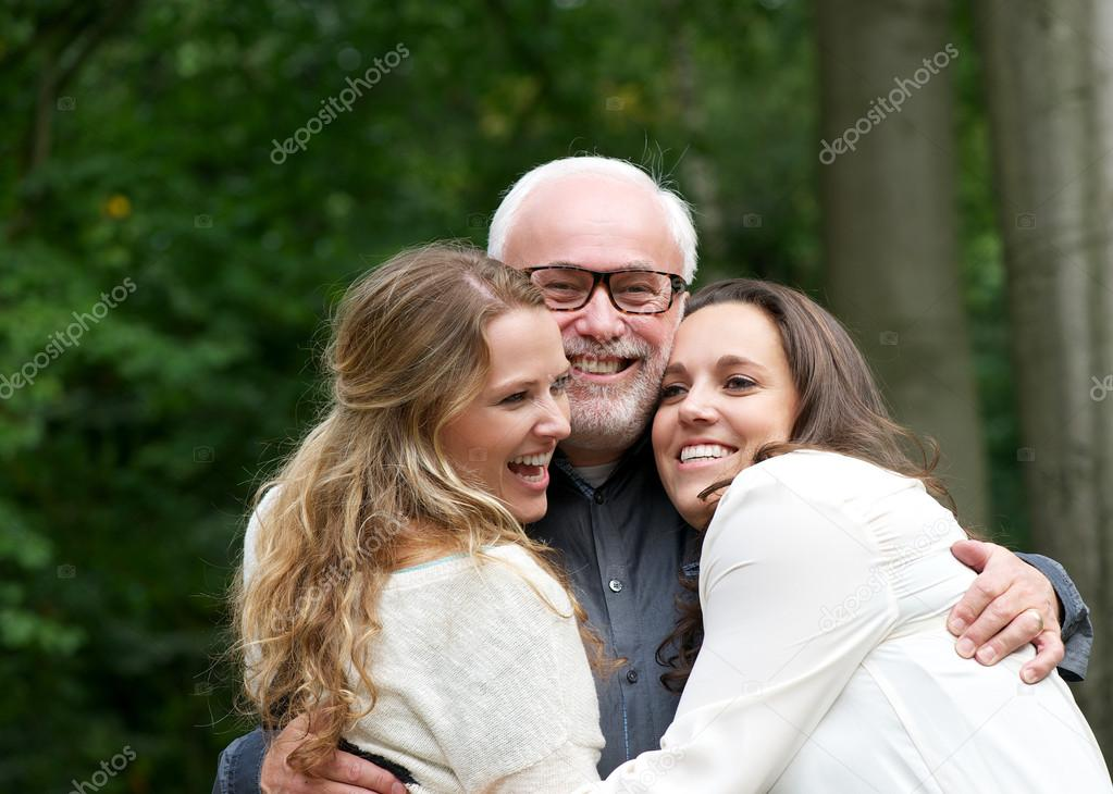 Portrait of a happy family with father and two daughters