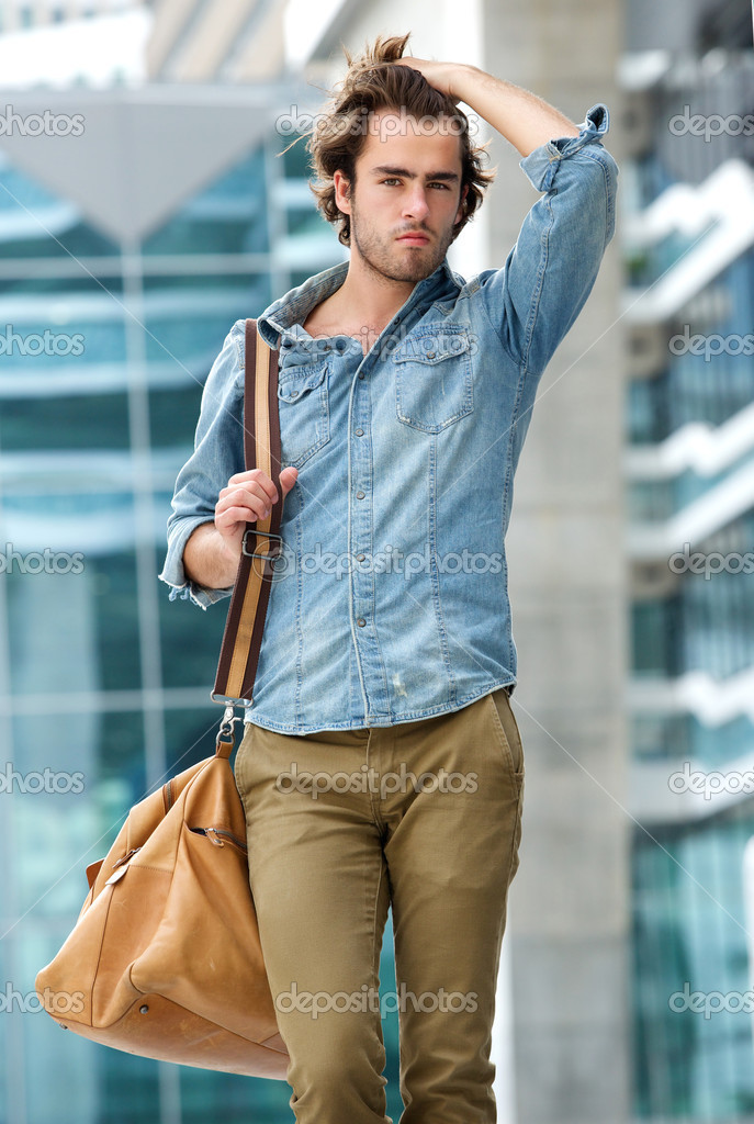 Male Model Posing With Travel Bag Outdoors Stock Photo C Mimagephotos 50081061