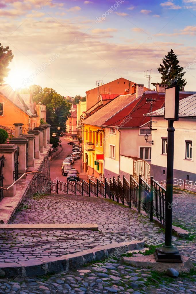 Фотообои curve cobbled streets of the old town goes down