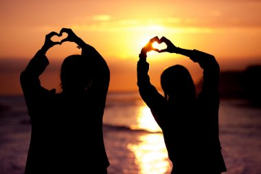 silhouette heart shape sunset