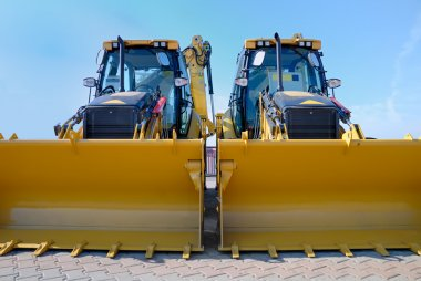 Two new bulldozers on a showcase