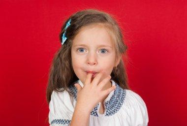 girl licking her fingers