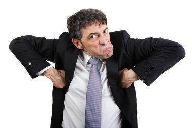 Businessman grimacing