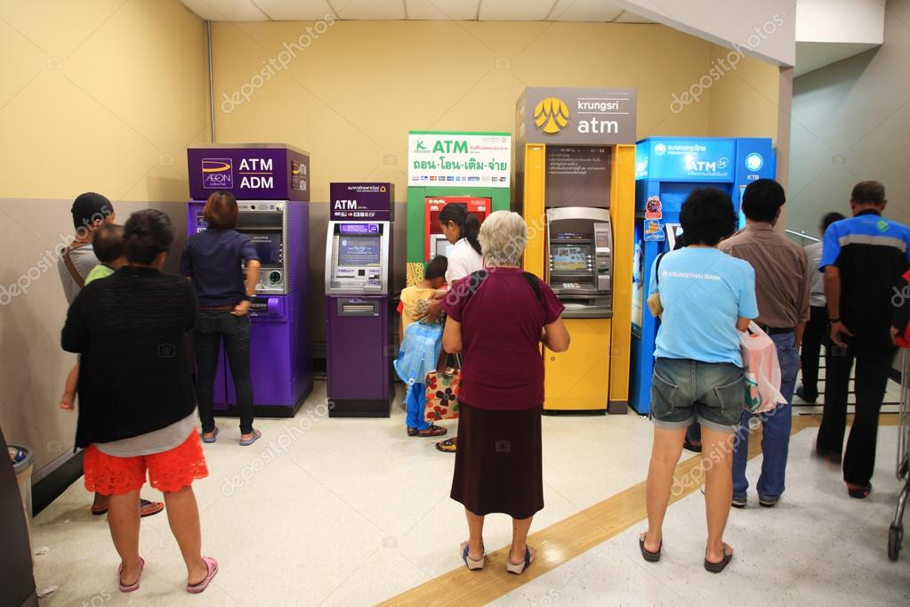 people queuing to withdraw cash in ATM