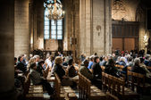Believers during Mass at Notre Dame Cathedral, Paris, France