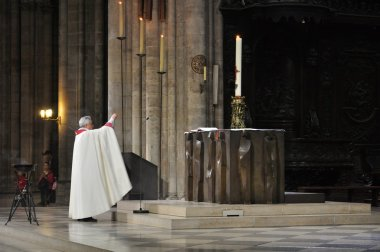 Priest during Mass at Notre Dame Cathedral, Paris, France