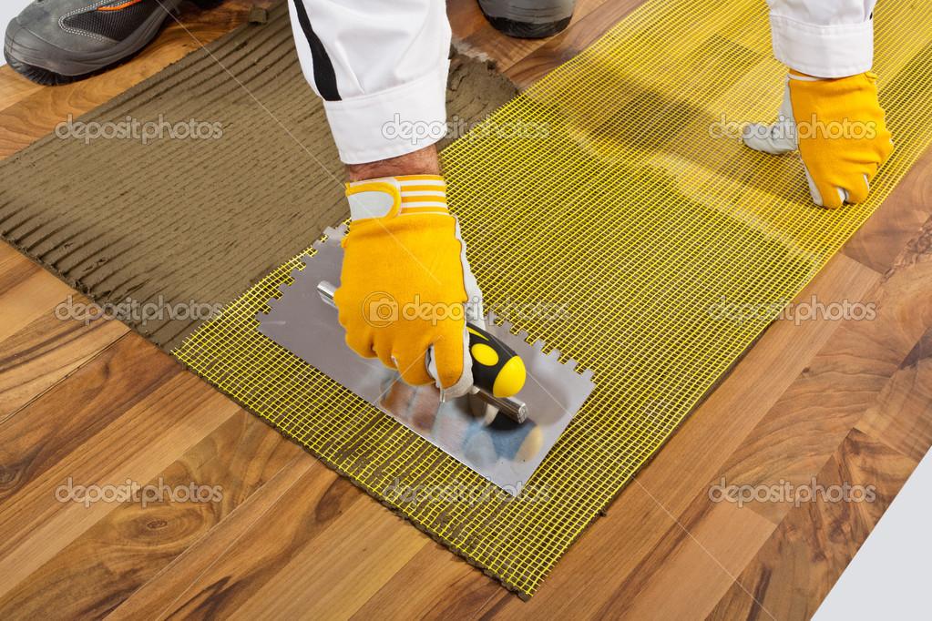 Applies Tile Adhesive On Wooden Floor With Reinforce Fiber Mesh U2014 Photo By  Csimagemakers