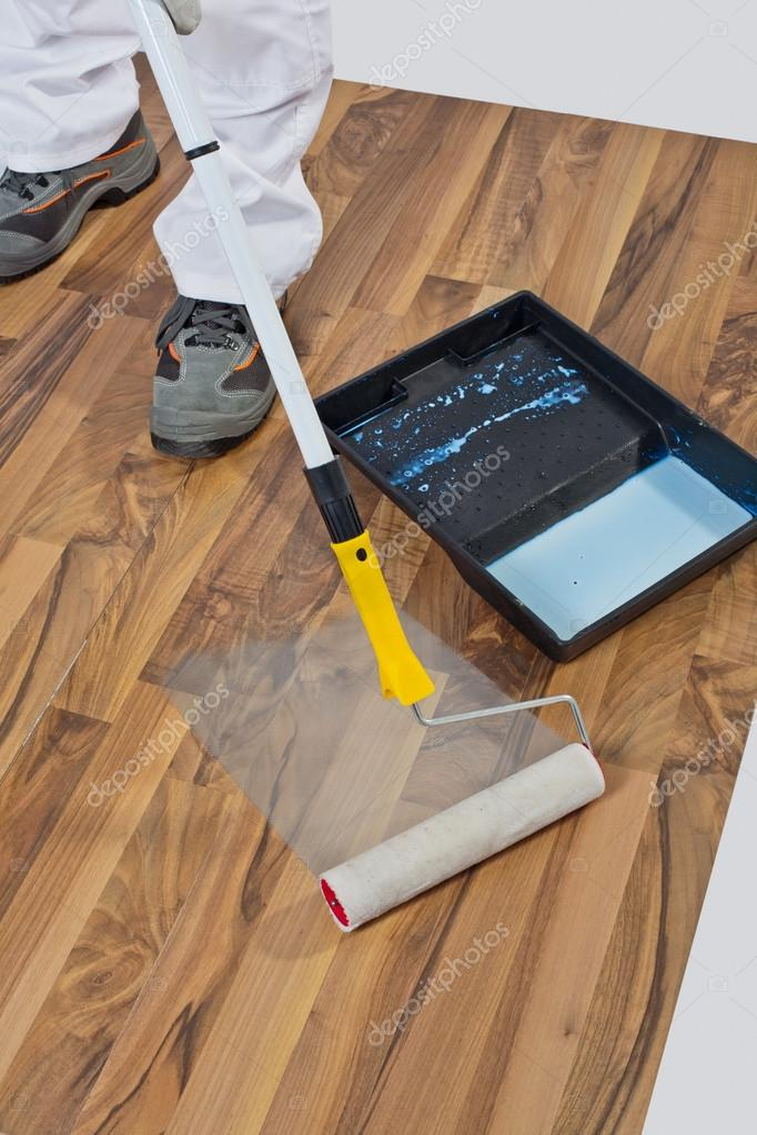 Painting With Primer Wooden Floor For Waterproofing Stock Photo