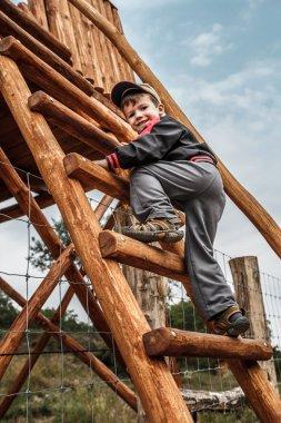 Little child climbing up