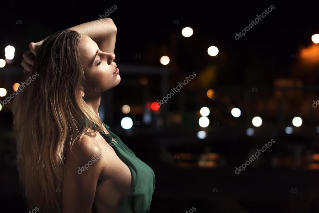Sensual woman posing at night