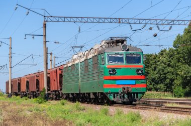 Electric locomotive hauling a grain train