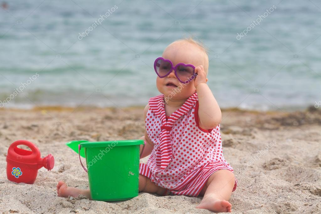 Portrait of kid resting on the beach in summer