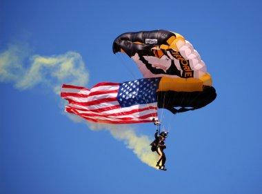 US Airborne parachutist above UM-MSU game