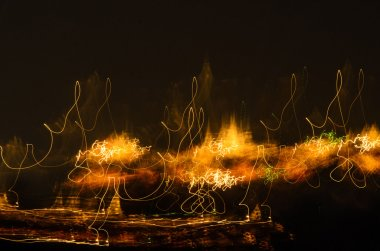Abstract light painting on black background, motion blur
