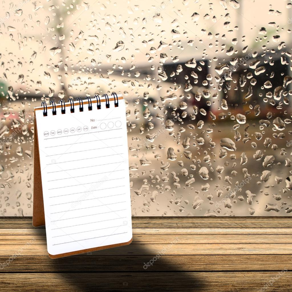 Notebook with  rainy day window background