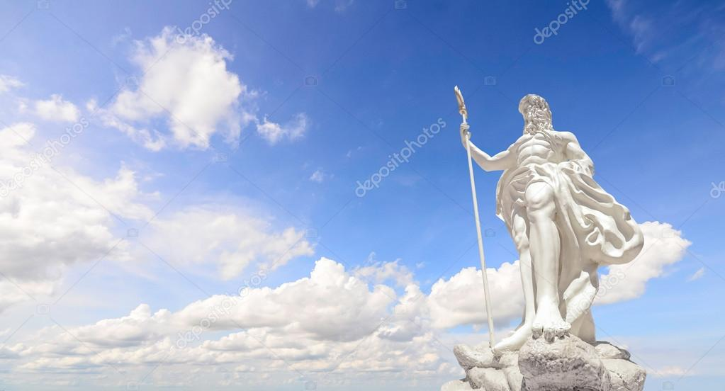 The statue of Poseidon and clear blue sky
