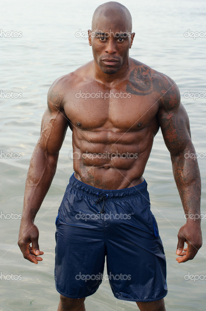 Black bodybuilder relaxing in the water after a hard
