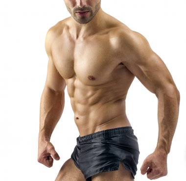 Strong bodybuilder man with perfect abs, shoulders,biceps, triceps and chest