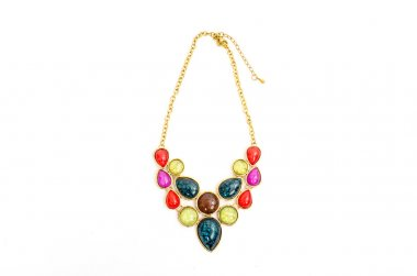 Close up with a colorful necklace isolated, beautiful red, yellow,green jewelery