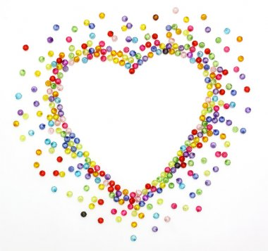 Colorful beads, heart shape space for photo or text isolated on