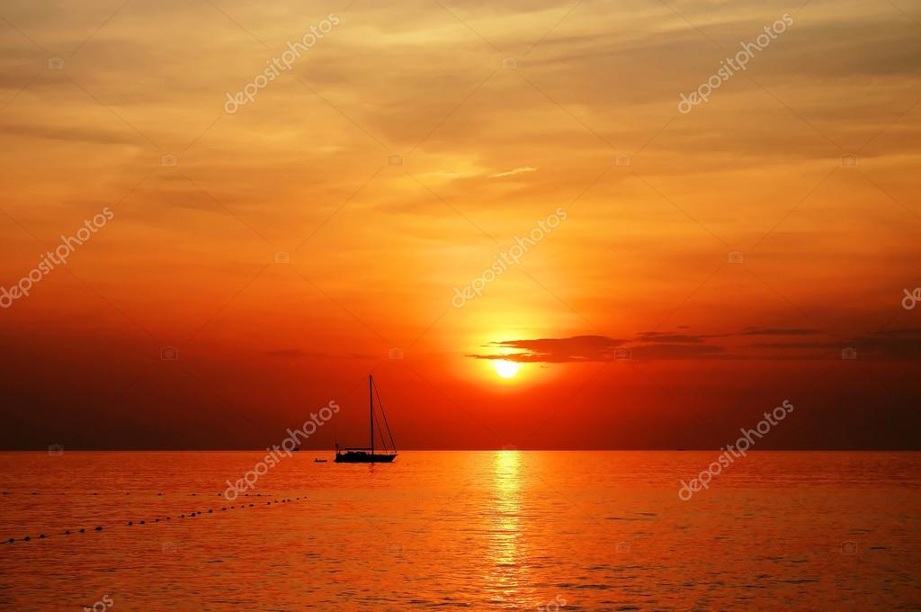 Sailing boat sunset at kata beach phuket