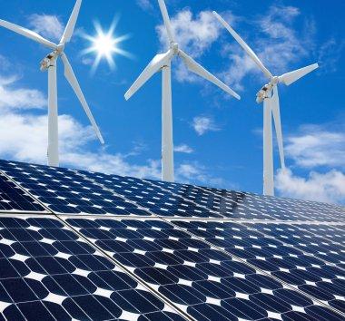 Solar panels and Wind Turbines sunny day blue sky