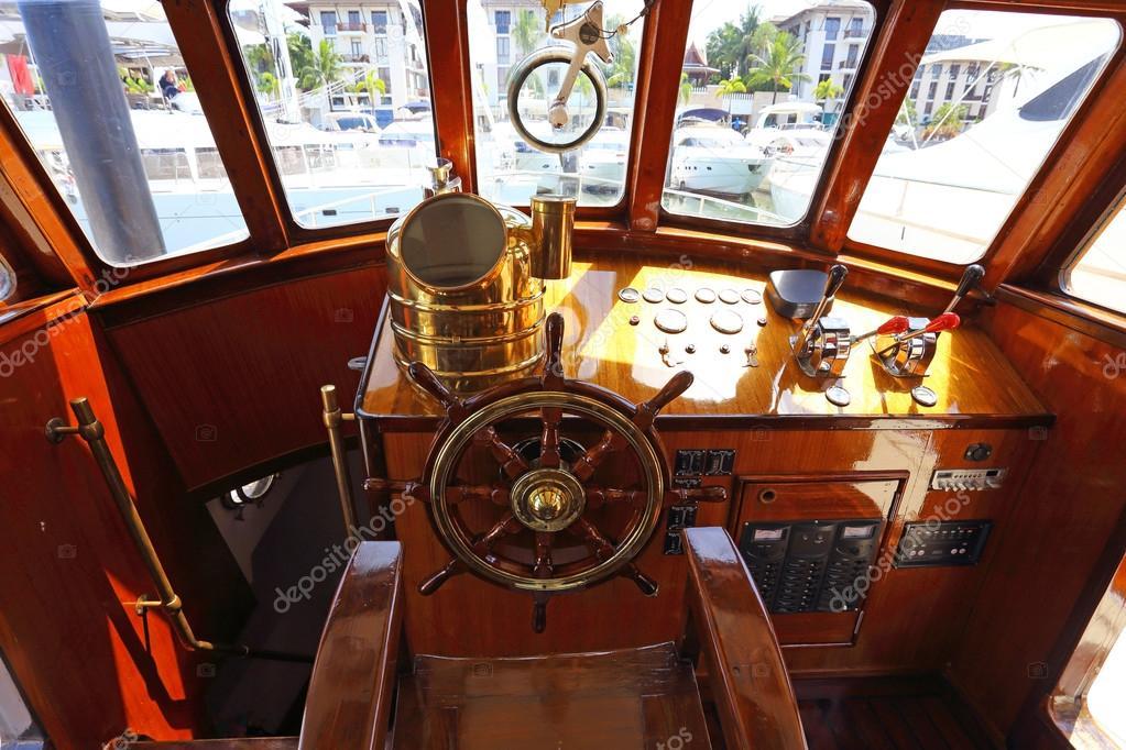 Steering wheel on a luxury yacht cabin.