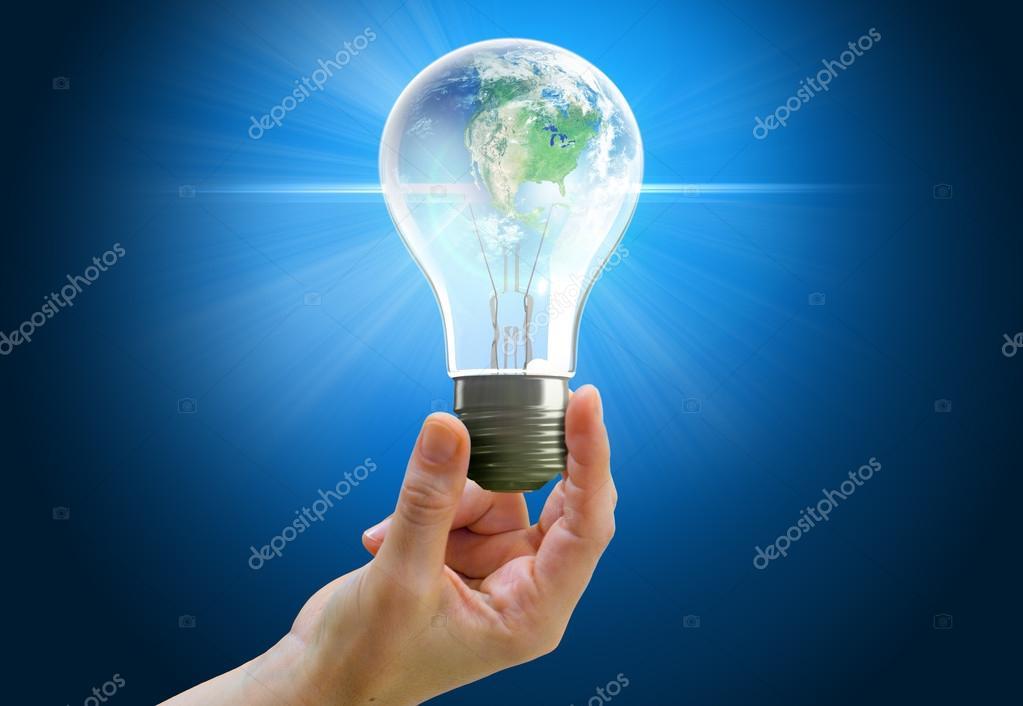 Hand holding light bulb globe