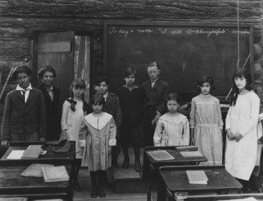 Group portrait of children standing in classroom stock vector
