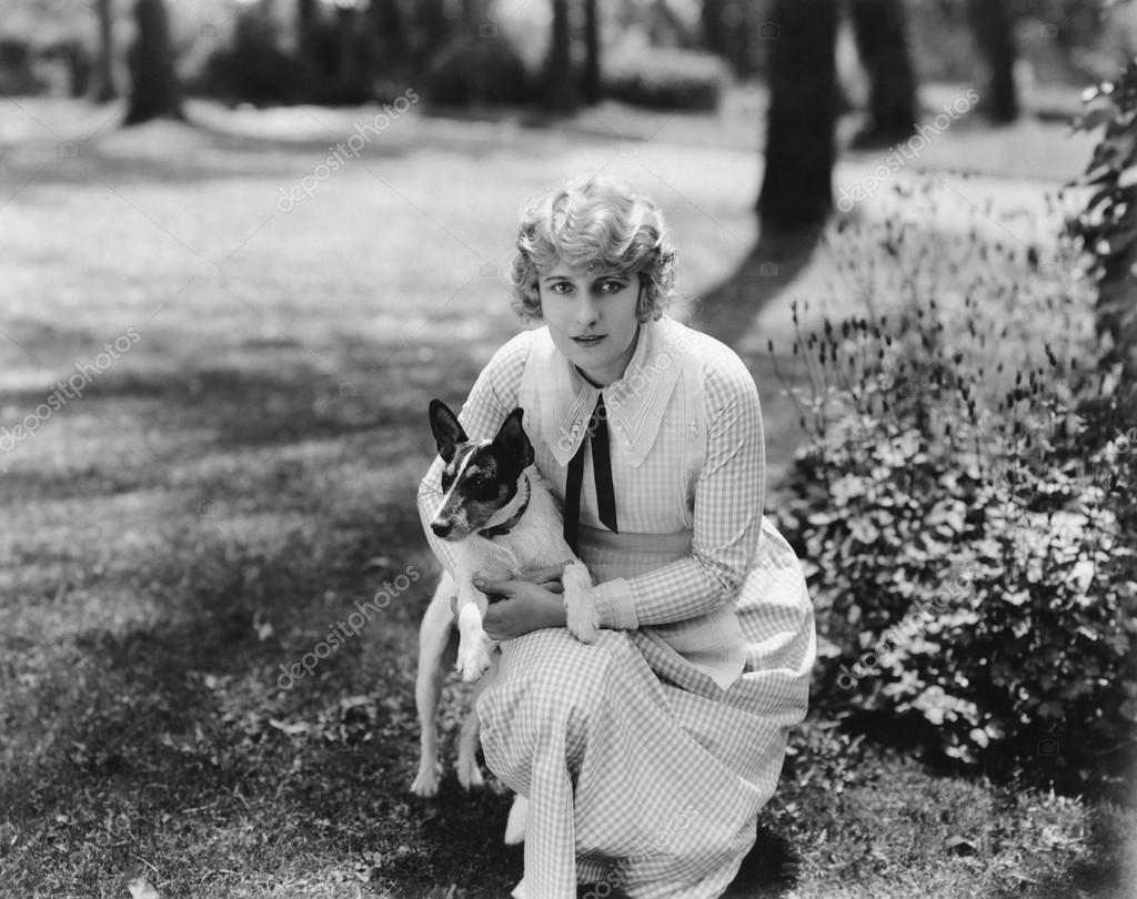 Woman posing with herJack Russell terrier