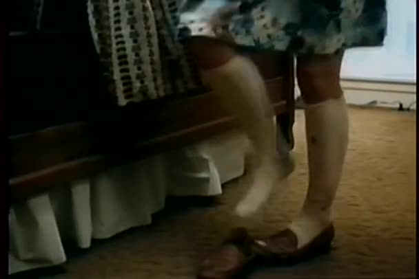 Close-up of woman's legs while she changes clothes