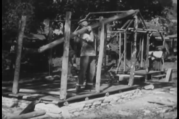 Man trying to build house frame