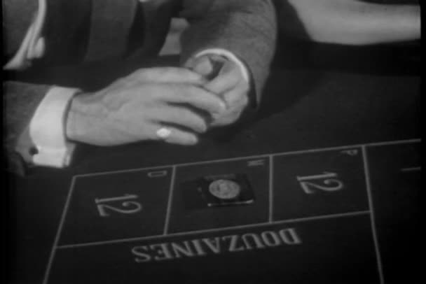 Close-up of hands placing bet then changing it