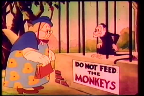 cartone animato di una donna rimproverando scimmia in gabbia per alimentare lo