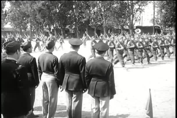 Parade of American soldiers marching as crowd watches