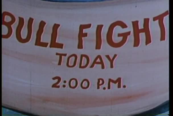 Pan down a cartoon bull fight sign