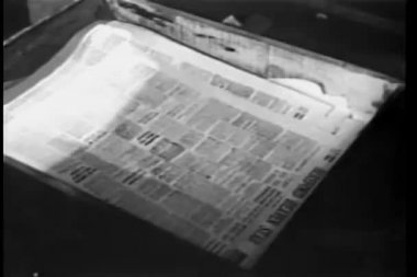 Close Up Of Newspapers Printed On Printing Press