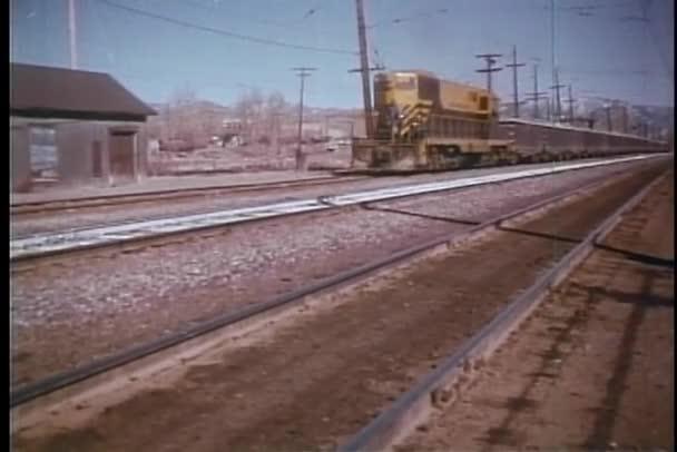 Freight train passing through railway station
