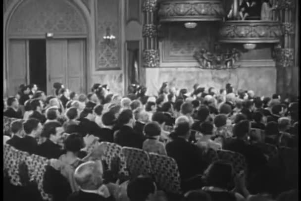 Audience clapping during theatrical performance