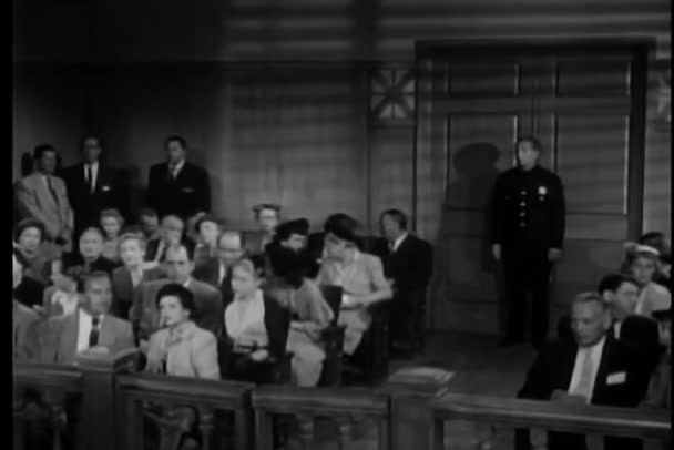 Audience discussing in courtroom