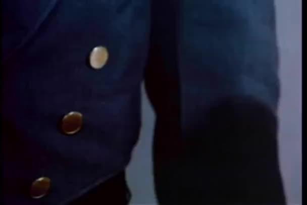 Close-up of man slipping doorman 50 dollars during handshake