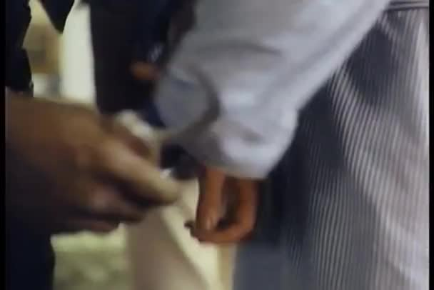 Close-up of police officer handcuffing suspect