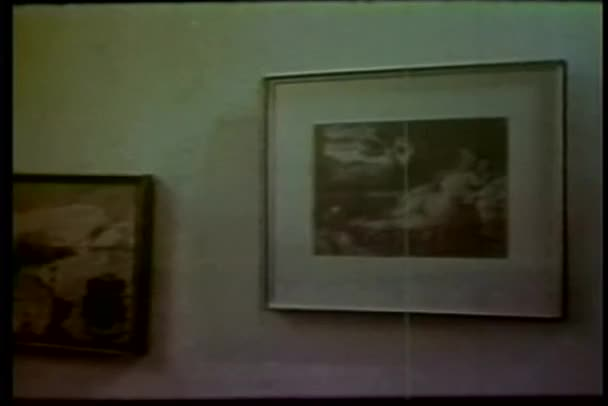 Chandelier, vase and picture frames on wall shaking