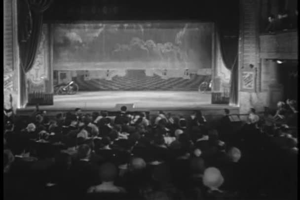 Wide shot of clown on stage beginning performance