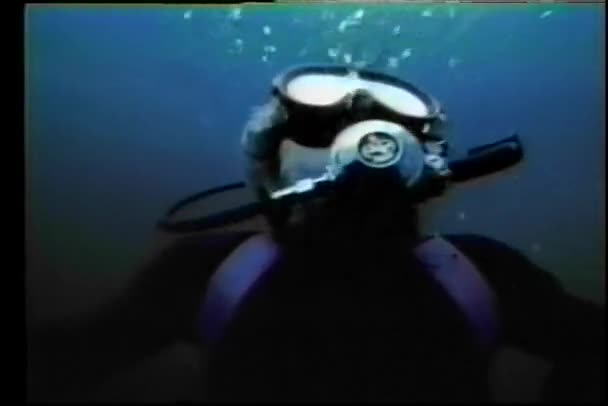 Scuba diver swimming to surface