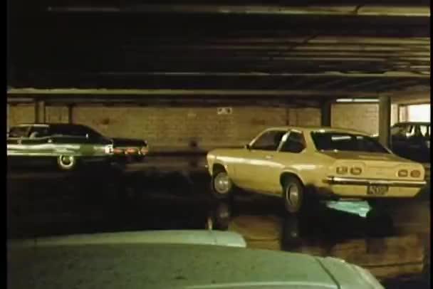 Car speeding through parking garage