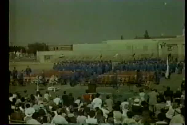 Wide shot of students attending high school graduation